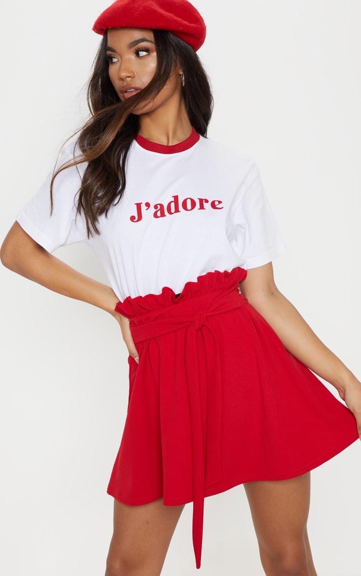 Mini-jupe trapèze rouge nouée à la taille