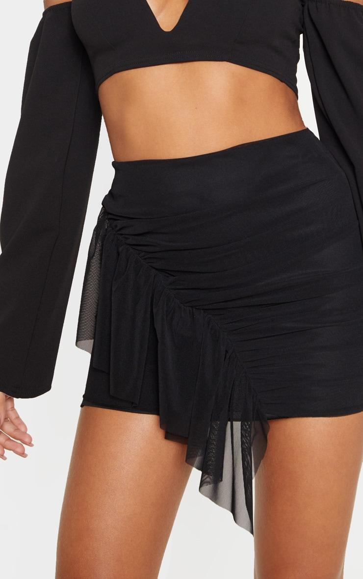 Mini-jupe en mesh noir à volants  6