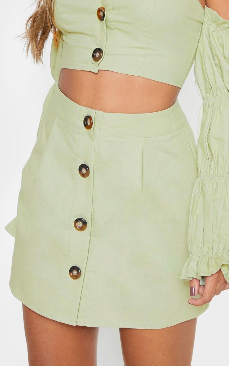 Mini-jupe vert menthe en coton à boutons devant 6