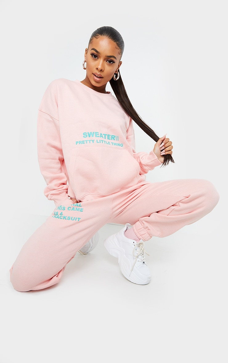 PRETTYLITTLETHING Light Pink Oversized Graphic Print Pocket Front Sweater 3