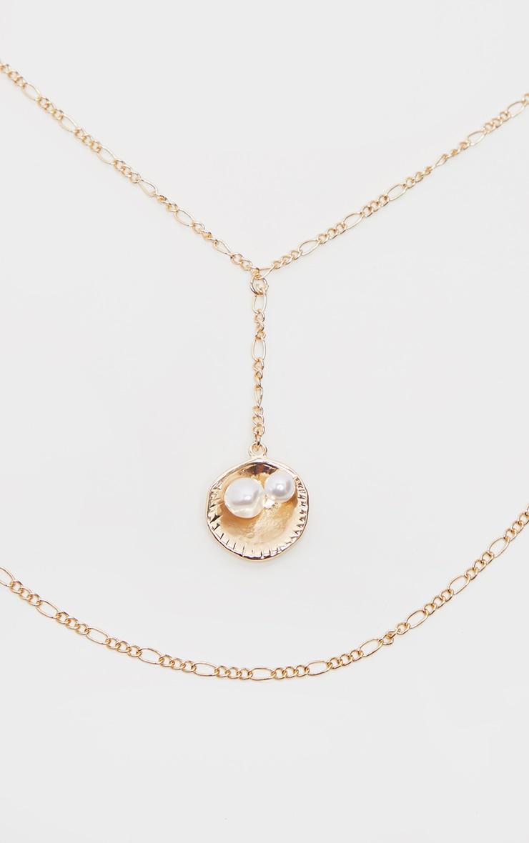 Collier doré à double chaîne, coquillage et perle 2