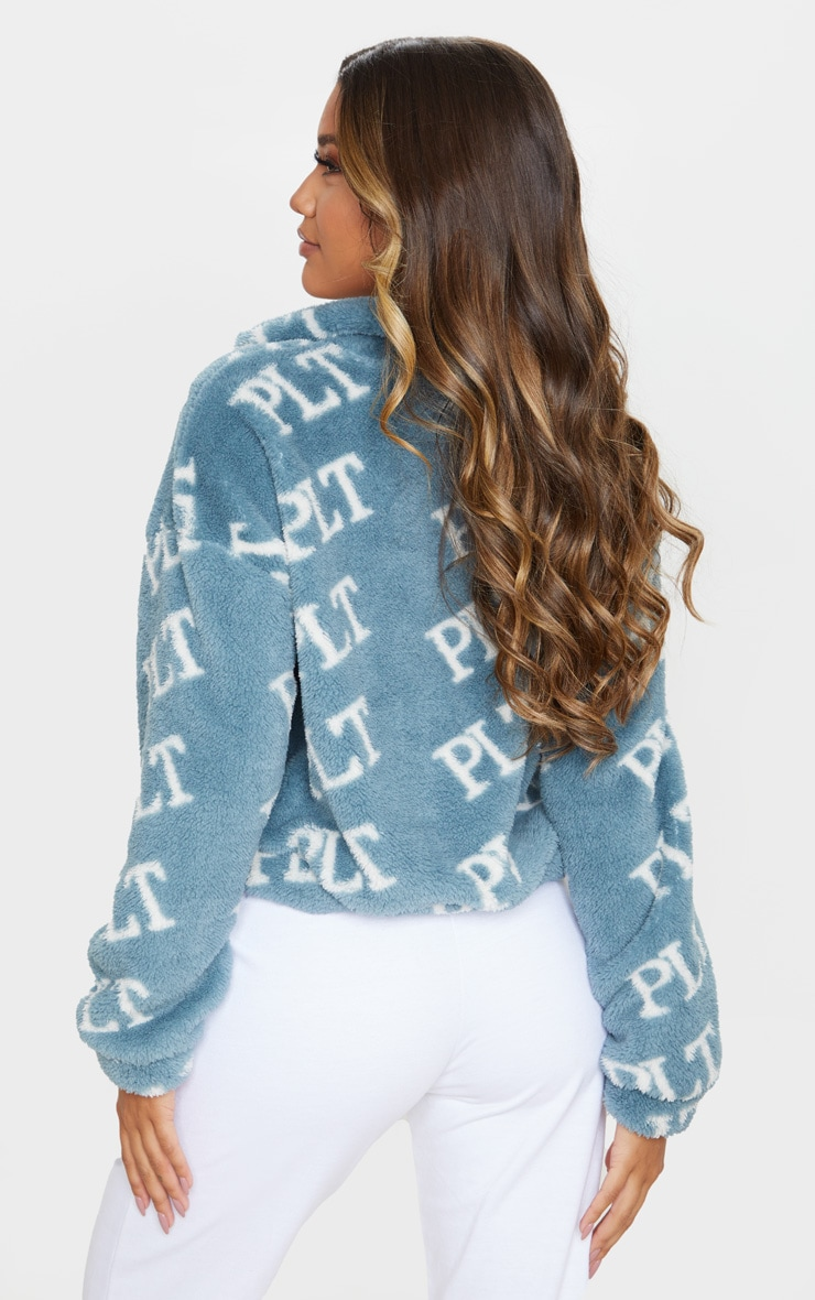 PRETTYLITTLETHING Teal Printed Zip Borg Crop Sweater 2