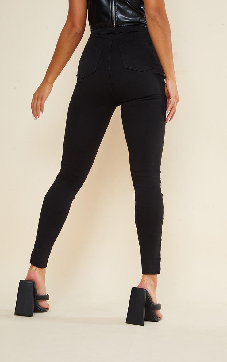 PRETTYLITTLETHING Petite Black Raw Hem Knee Rip Disco Skinny Jean 3