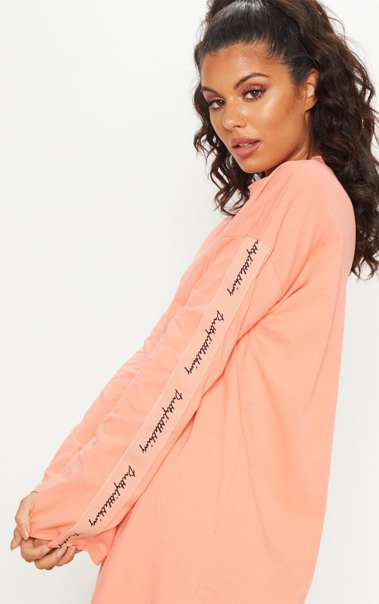 PRETTYLITTLETHING Neon Peach Tape Long Sleeve T Shirt Dress 5