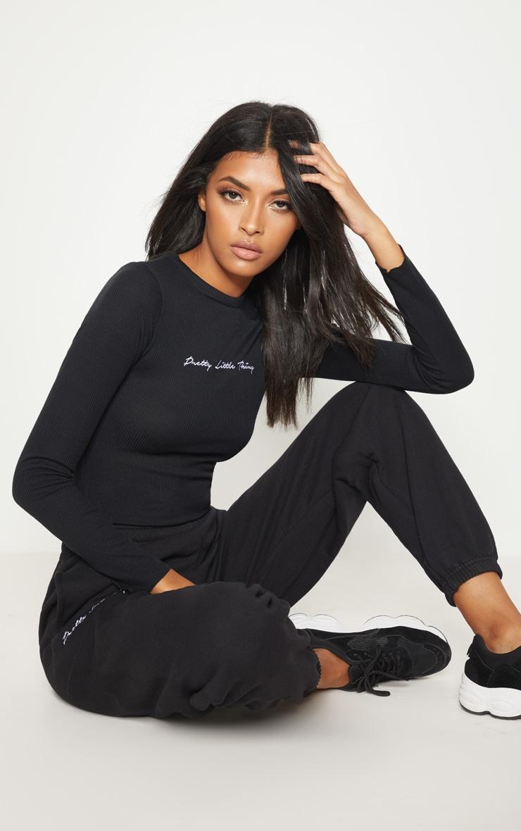 PRETTYLITTLETHING Black Rib Embroidered Bodysuit  1