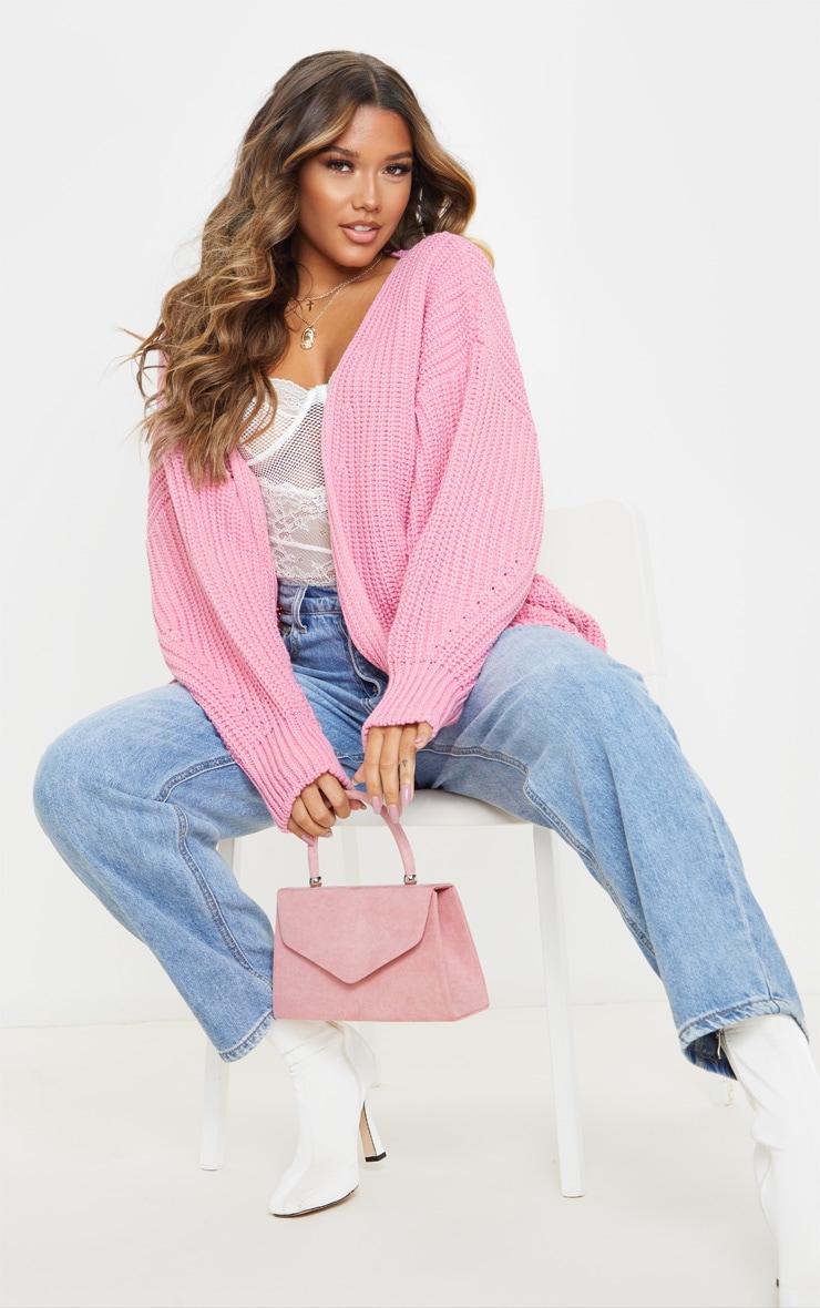 Cardigan ample à grosse maille rose 1