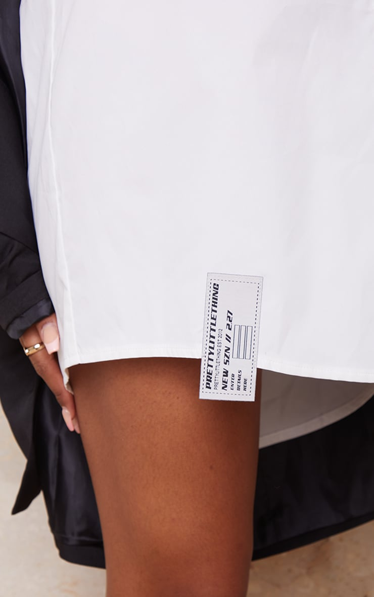 PRETTYLITTLETHING - Robe chemise blanche à détail ourlet 4