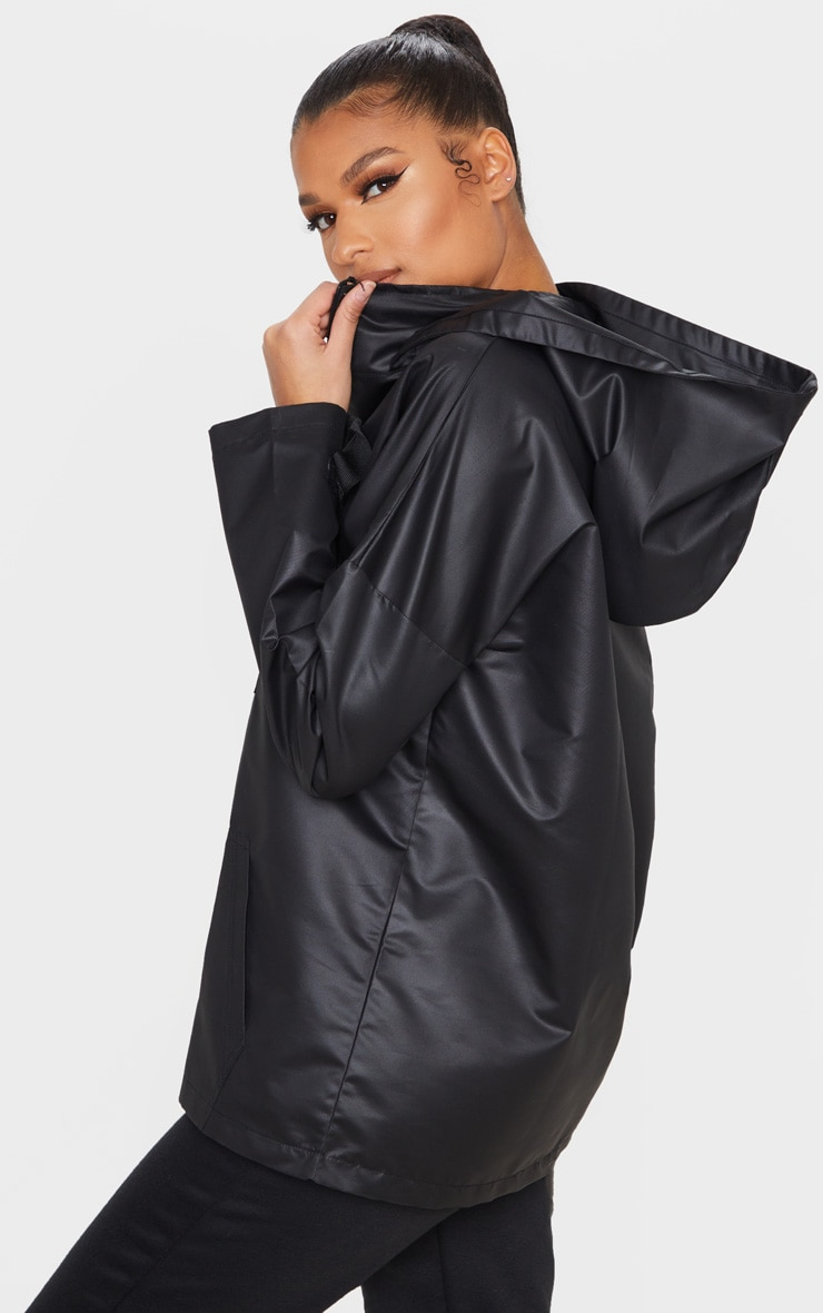 PRETTYLITTLETHING Black Pocket Front Hooded Pull Over Mac 2