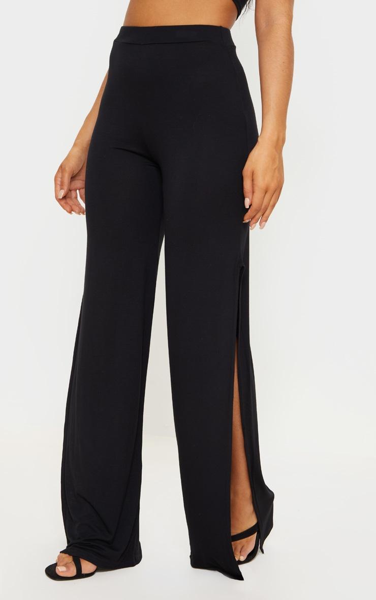 Pantalon taille haute en jersey noir à jambes évasées fendues 2