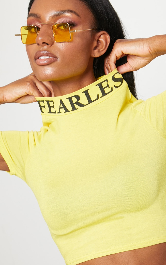 YELLOW FEARLESS PRINTED CROP T SHIRT