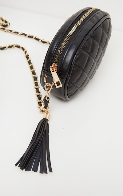 Black Quilted Circle Cross Body Bag