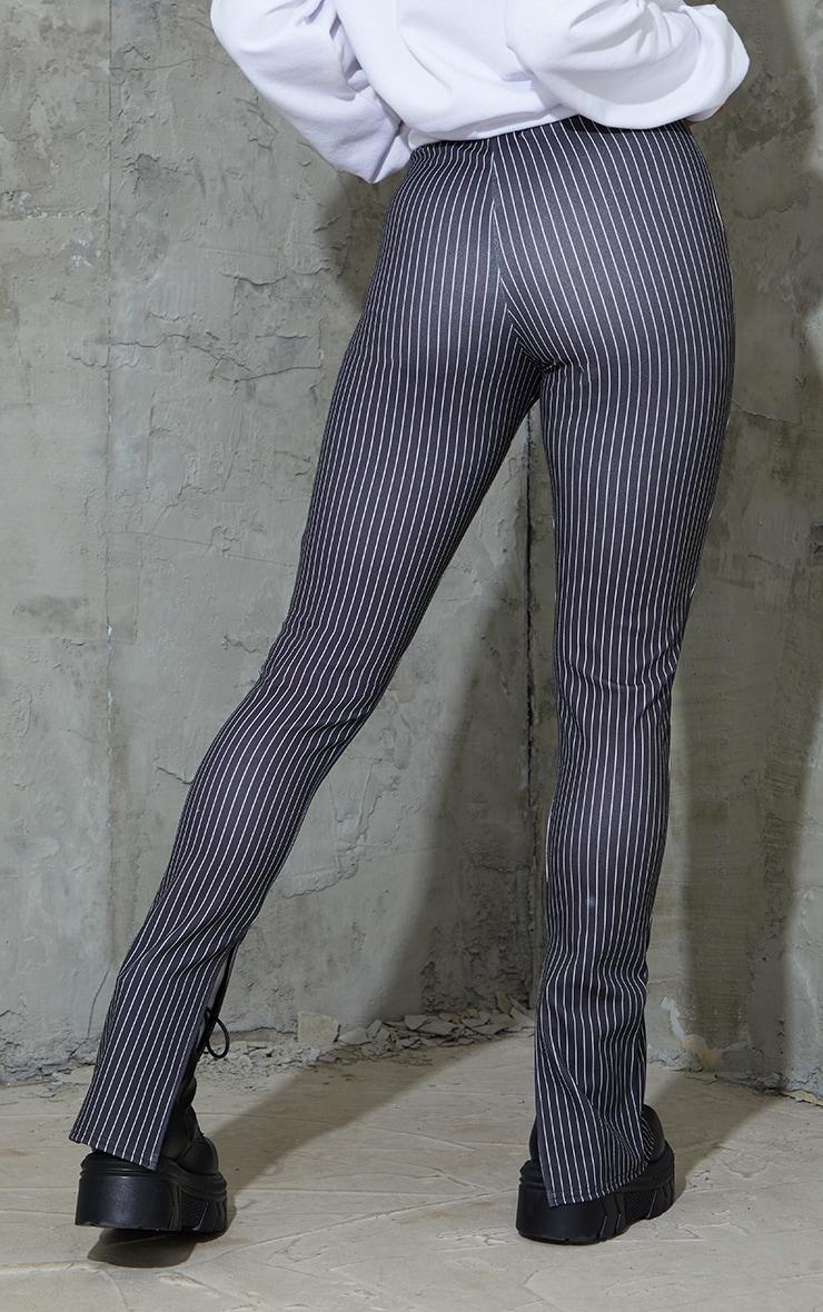 Pantalon skinny rayé noir à détail coutures et ourlet fendu 3