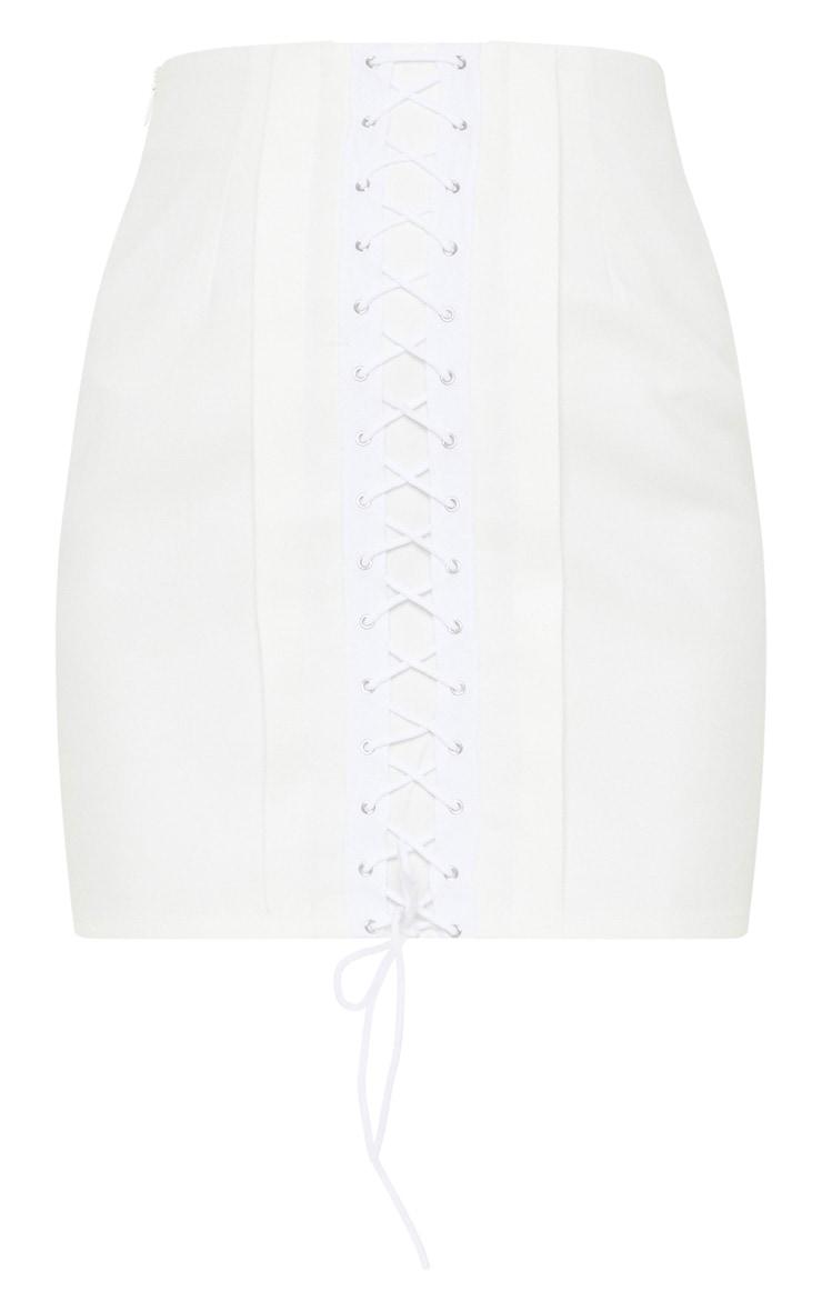 Mini-jupe blanche à détail lacets 3
