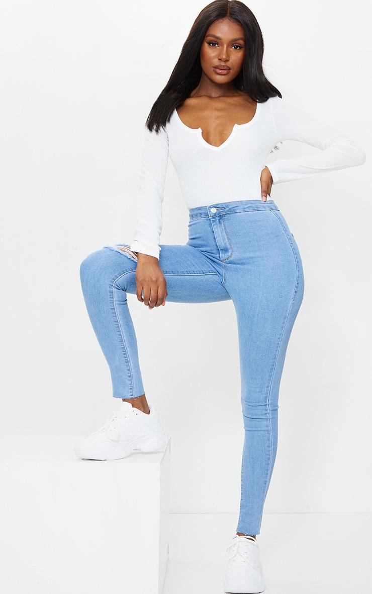 PRETTYLITTLETHING Tall Light Blue Wash Raw Hem Knee Rip Disco Skinny Jean 1