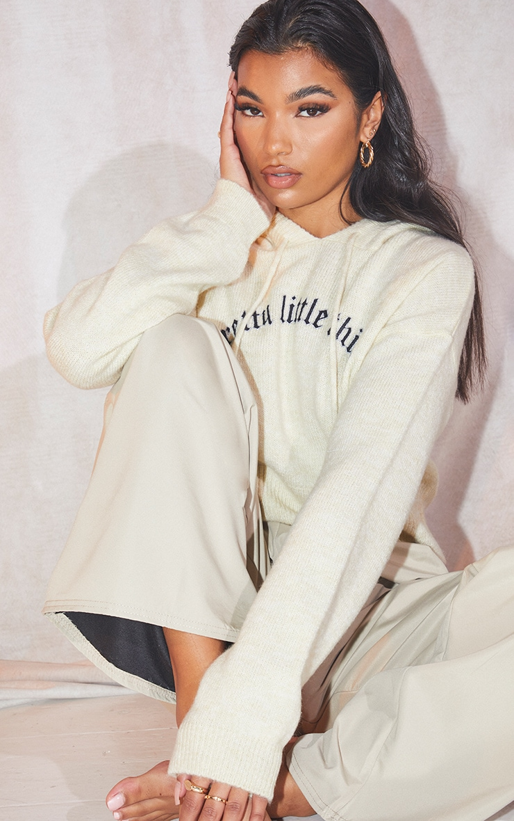 PRETTYLITTLETHING Cream Slogan Printed Knitted Crop Hoodie 1