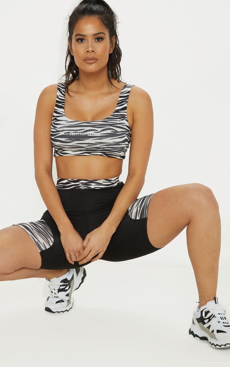PRETTYLITTLETHING Zebra Gym Crop Top 1
