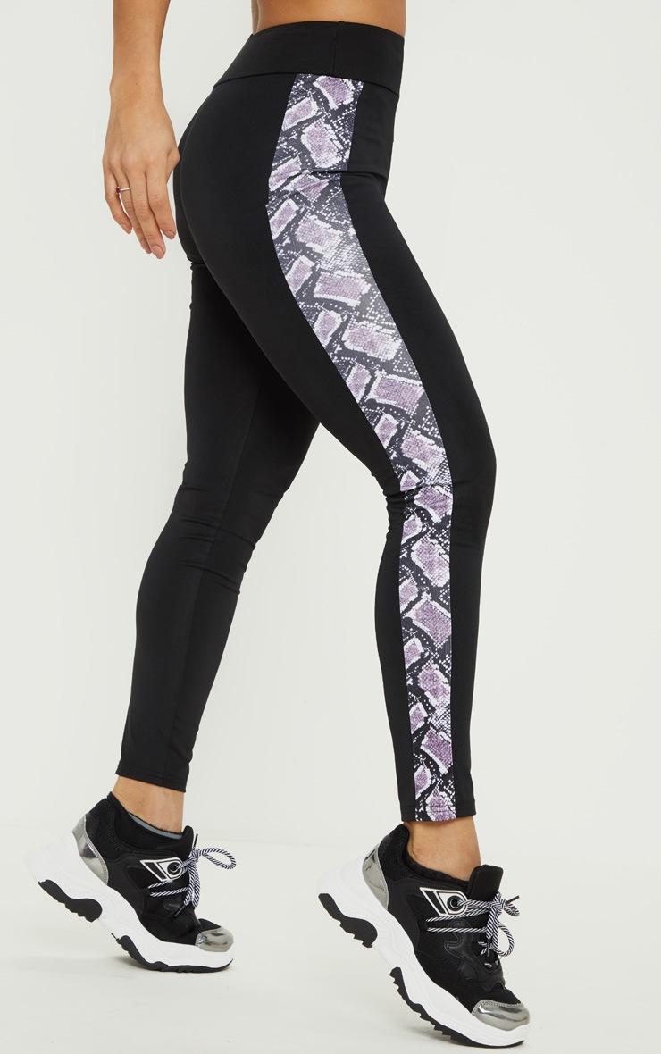 Legging de sport noir à bandes latérales imprimé serpent 2