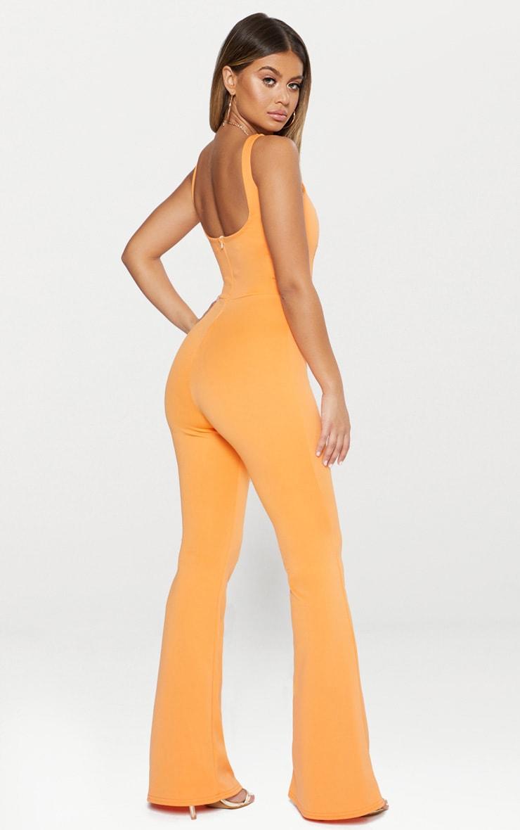 Combinaison orange à encolure carrée et coutures apparentes 2