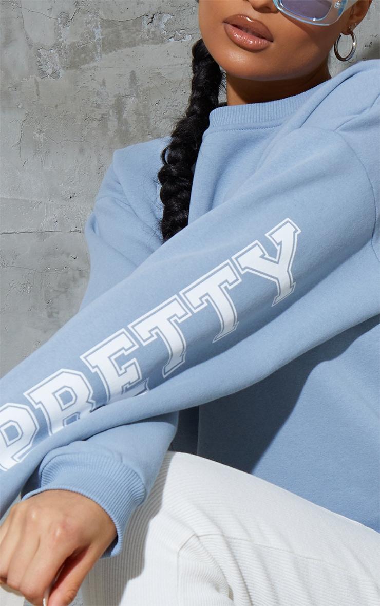 PRETTYLITTLETHING Dusty Blue Back Arm Print Slogan Sweatshirt 4