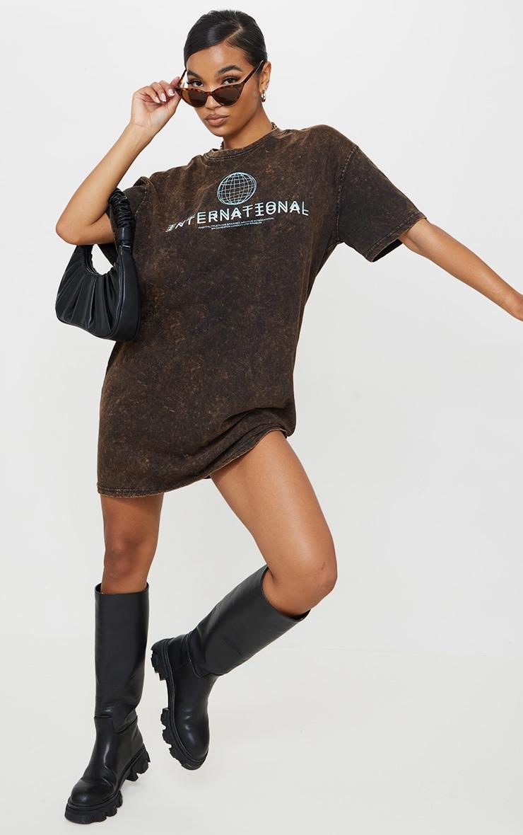 PRETTYLITTLETHING Rust Acid Wash International Slogan Oversized T Shirt Dress 1
