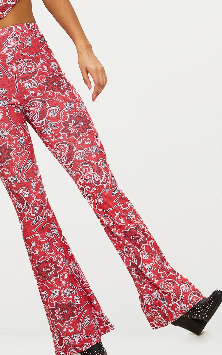 44cbe9e3c86b4 Red Paisley Printed Jersey Flare Pants | PrettyLittleThing USA
