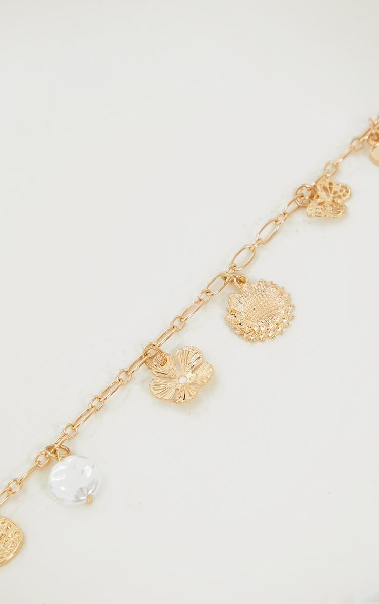 Collier doré à pendentifs variés 4