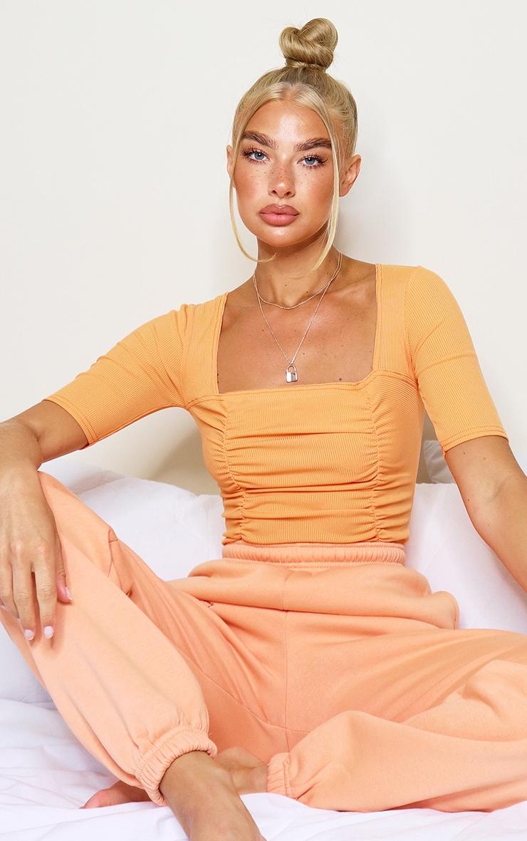 Pastel Orange Ruched Short Sleeve Bodysuit 1