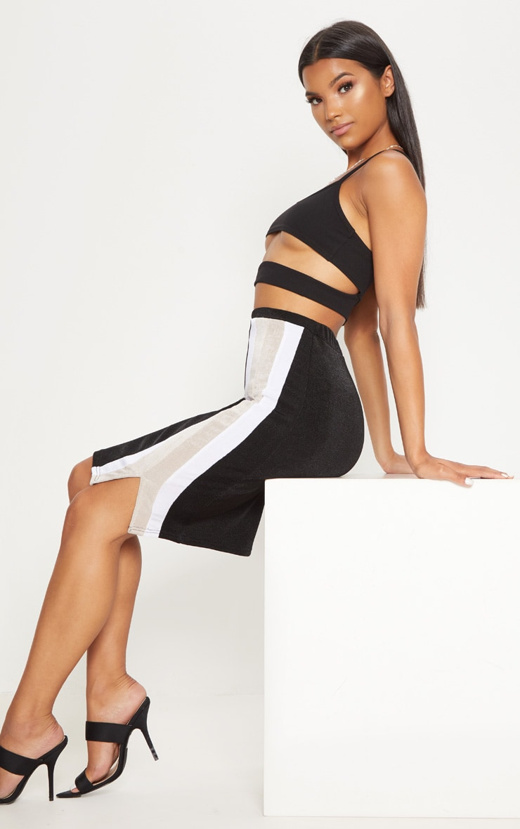 Jupe mi-longue noire fendue à bandes latérales style sport  5