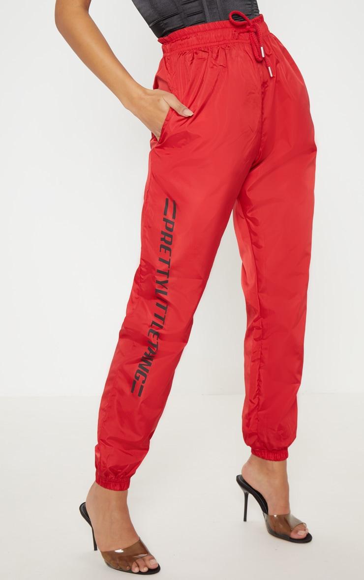 PRETTYLITTLETHING Logo Red Stripe Shell Jogger 2