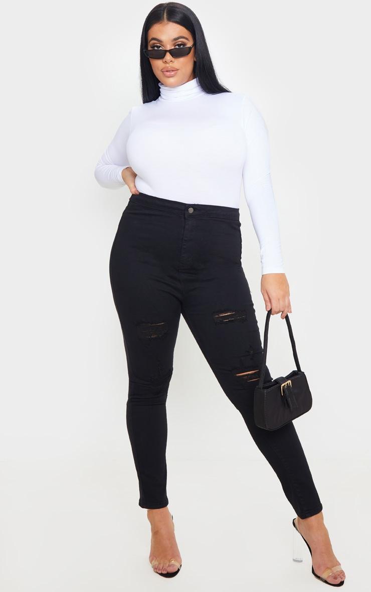 PRETTYLITTLETHING Plus Black Distressed Disco Jean 1