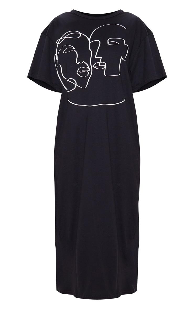 Robe mi-longue noire oversize à motif visages 3