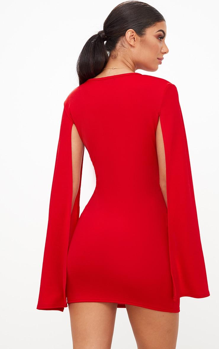 Robe moulante rouge fendue aux bras 2