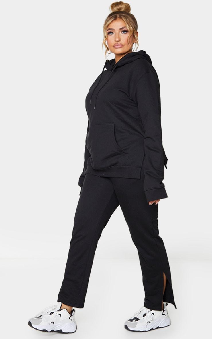 PLT Plus - Jogging noir à ourlet fendu 1