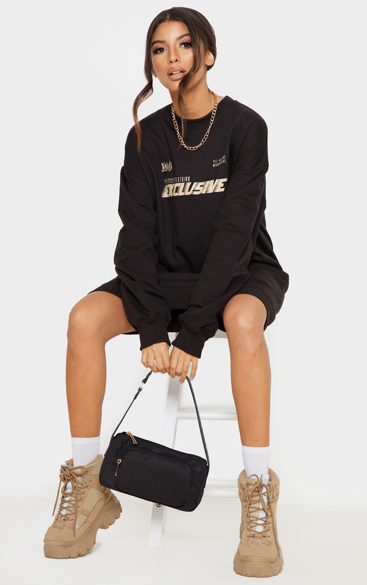 PRETTYLITTLETHING Black Exclusive Slogan Sweater Dress 1