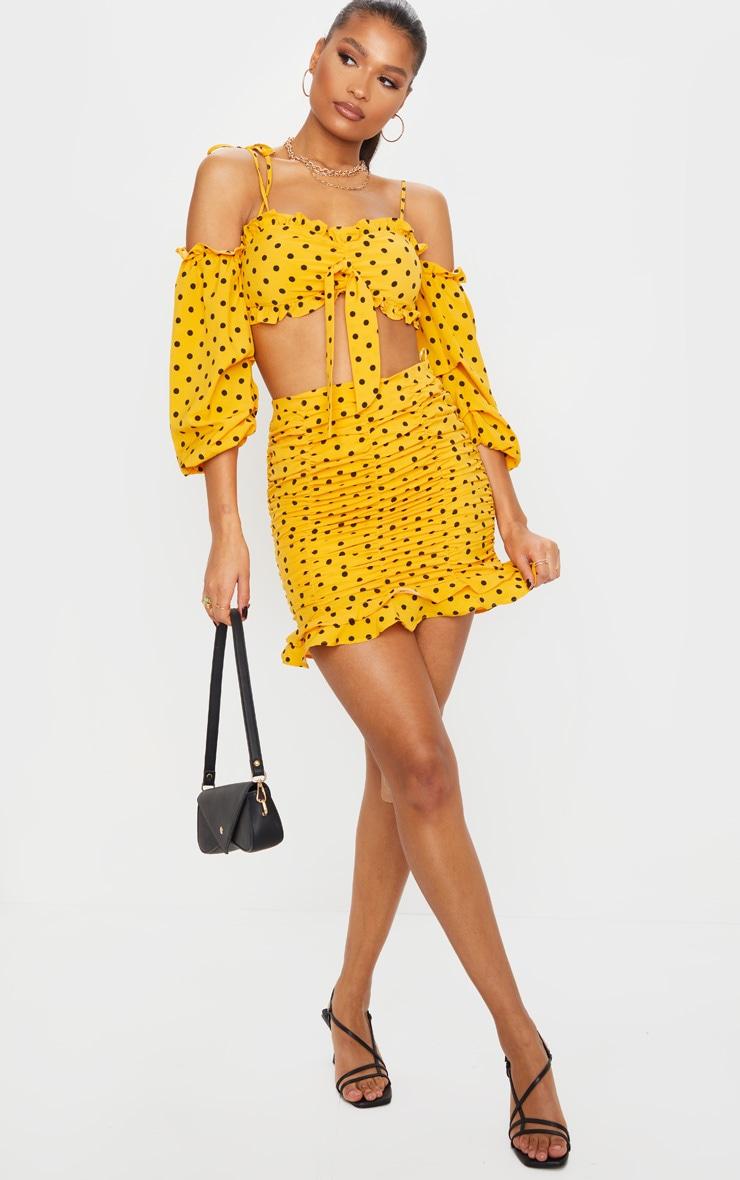 Mini-jupe froncée moutarde en maille tissée à pois 1