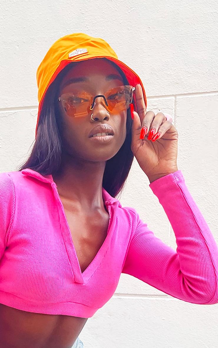 Orange Lens Framless Cat Eye Sunglasses 1