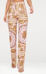 27ef2217291f Pantalon droit rose pâle à imprimé foulard. Pantalons ...