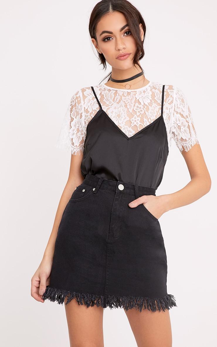 Jasminda minijupe en jean noire à ourlet à franges 1