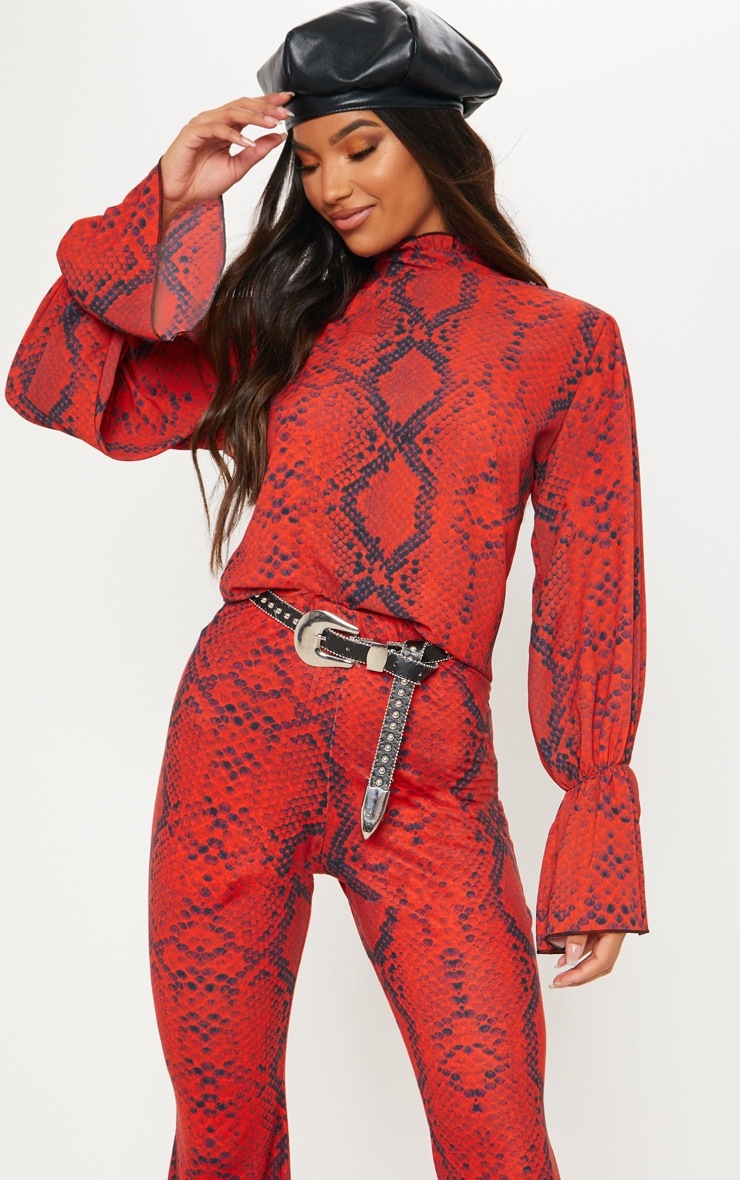 red snake flute sleeve high neck top