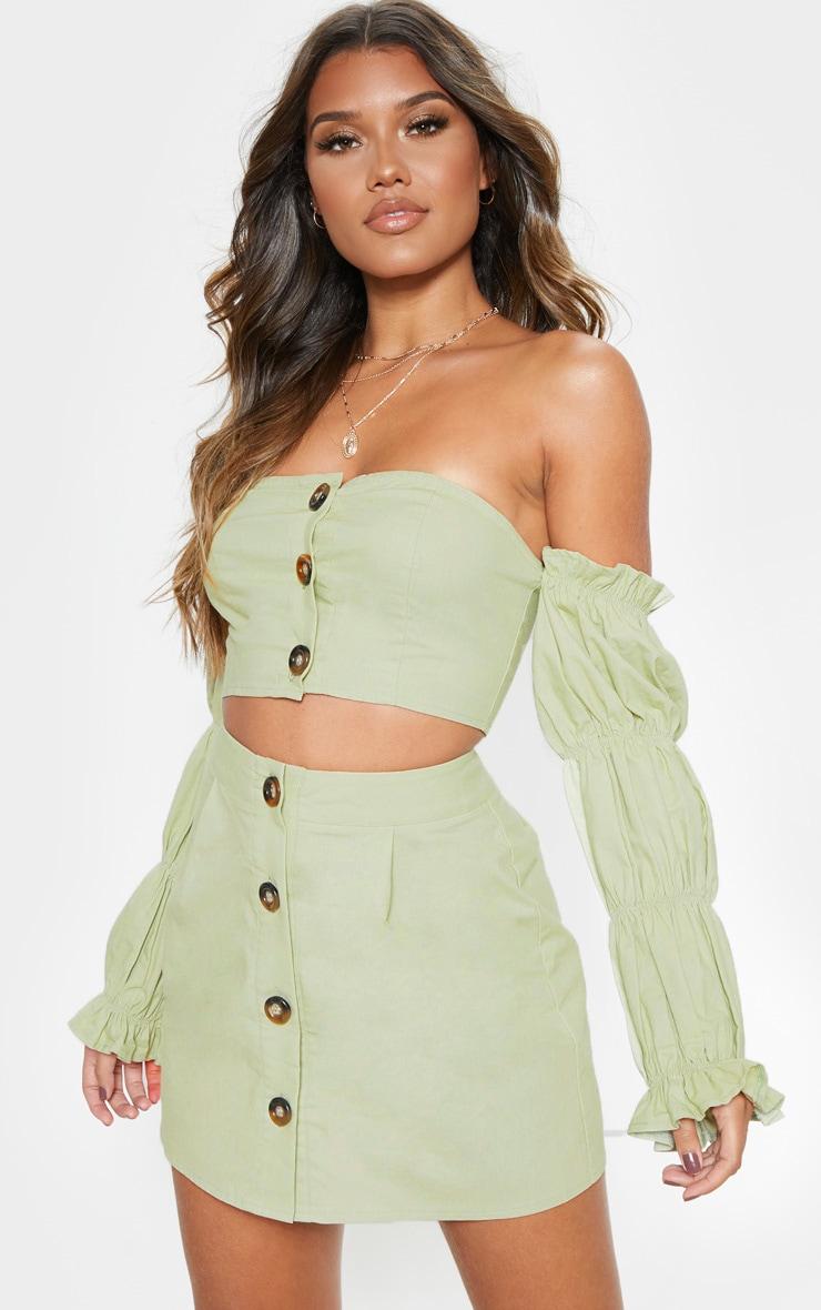 Mini-jupe vert menthe en coton à boutons devant 1