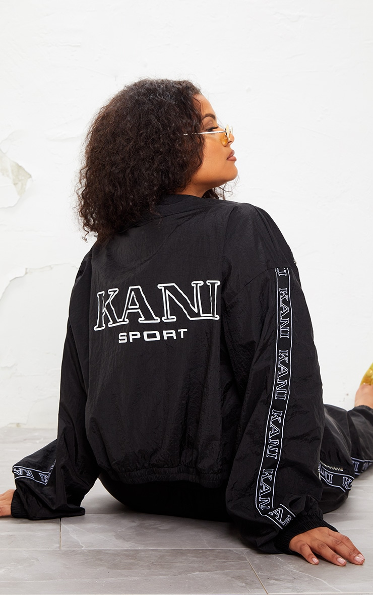 KARL KANI Black Tape Printed Shell Crop Windbreaker