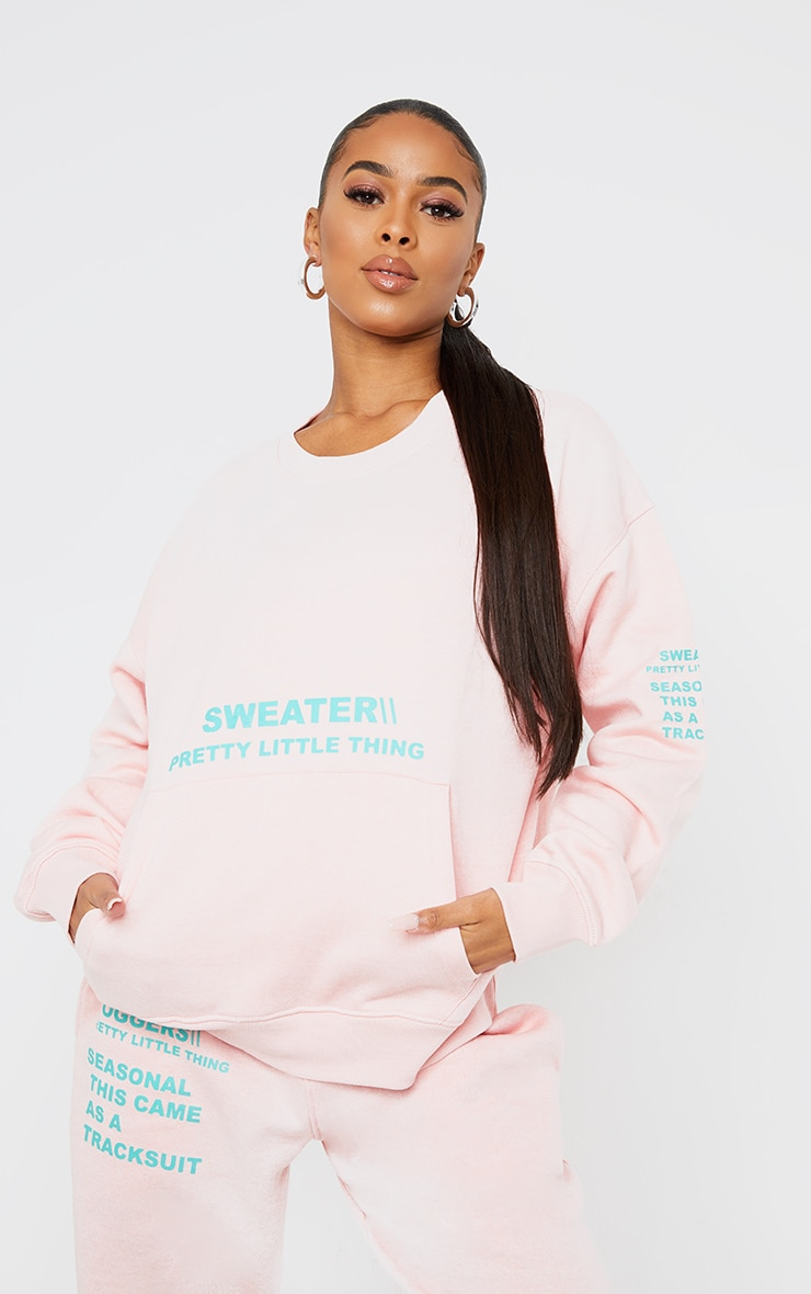 PRETTYLITTLETHING Light Pink Oversized Graphic Print Pocket Front Sweater 1