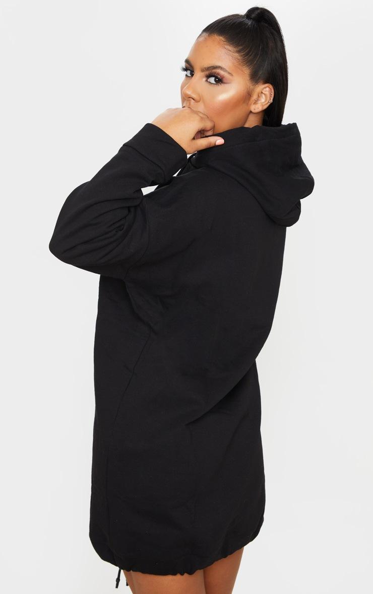 Robe pull noire oversize à poche frontale et cordons ajustables  2