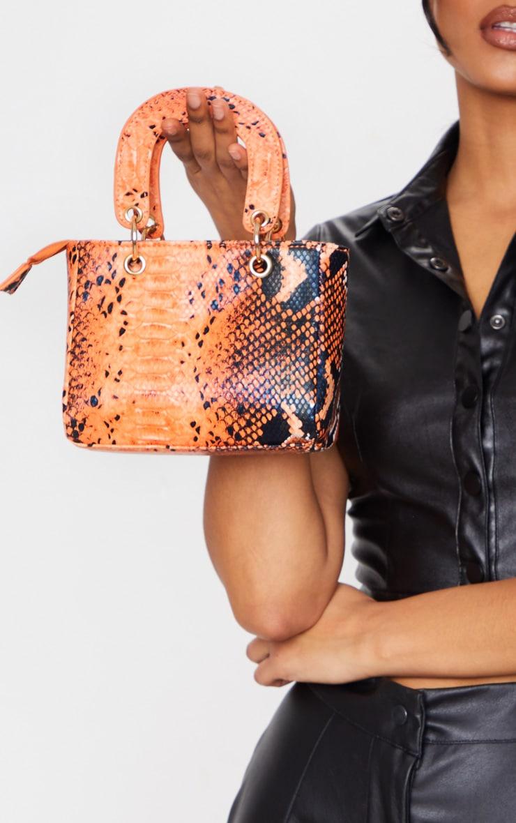 orange snake ring detail cross body bag