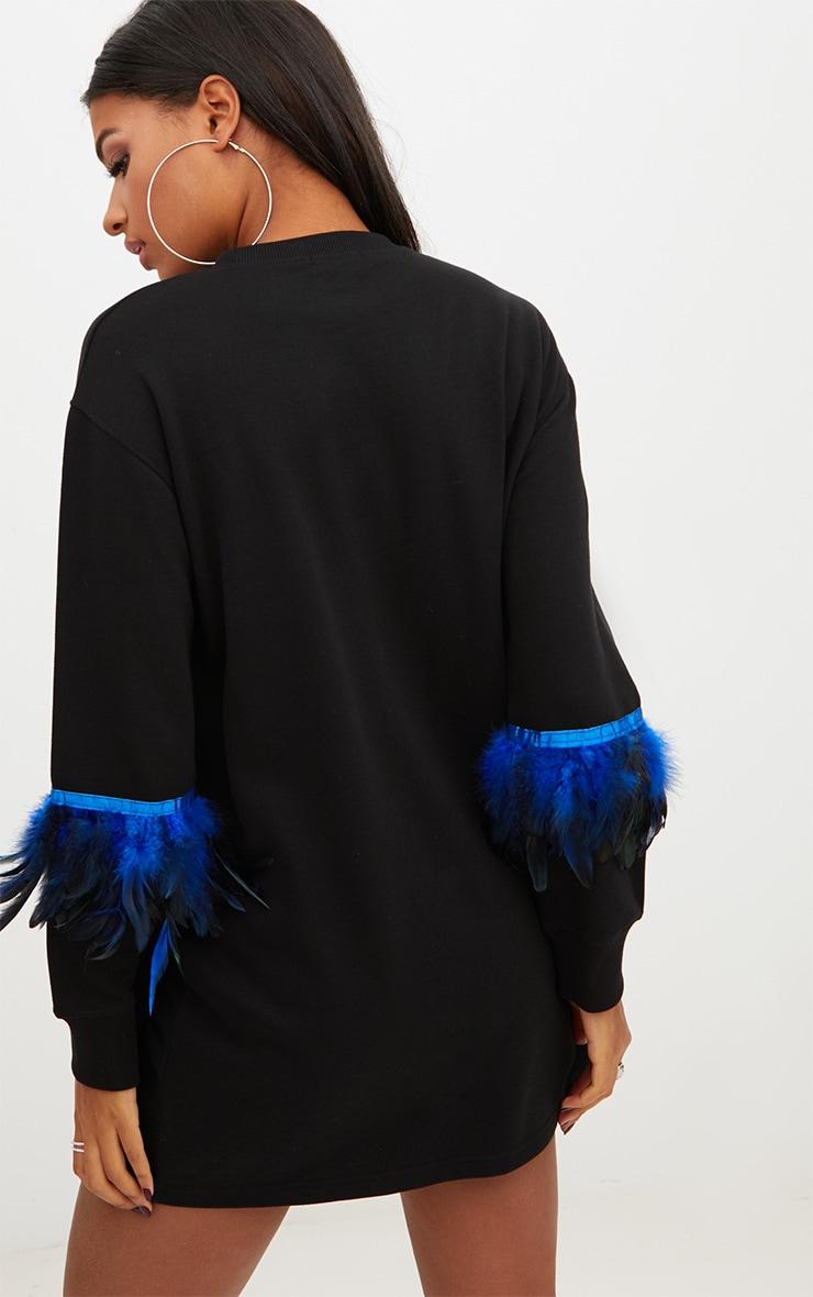 Robe sweat noire avec plumes sur les manches 2