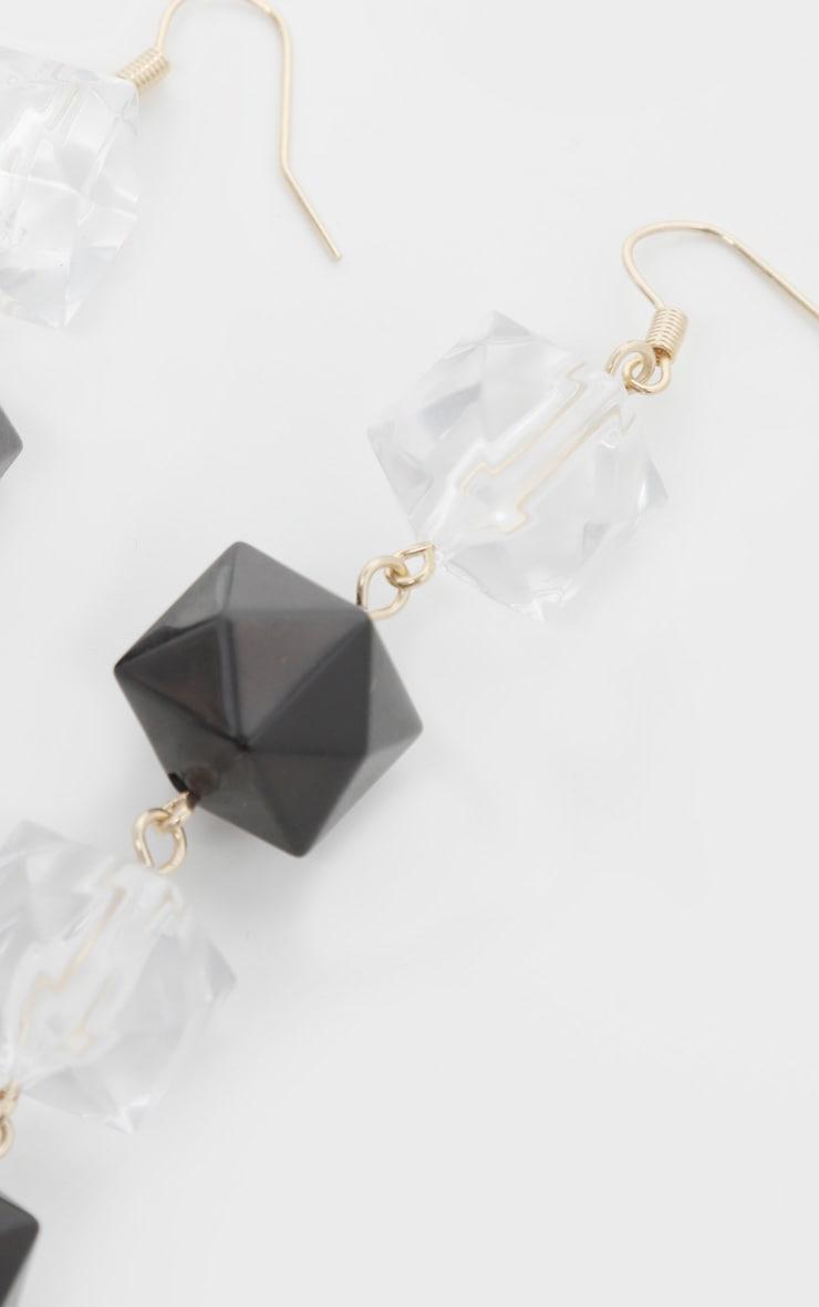 Boucles d'oreilles à pendants perles noires et blanches 3