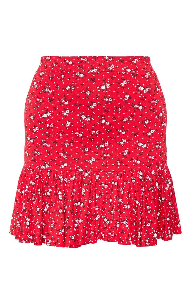 Mini-jupe rouge à petites fleurs et ourlet volanté 3