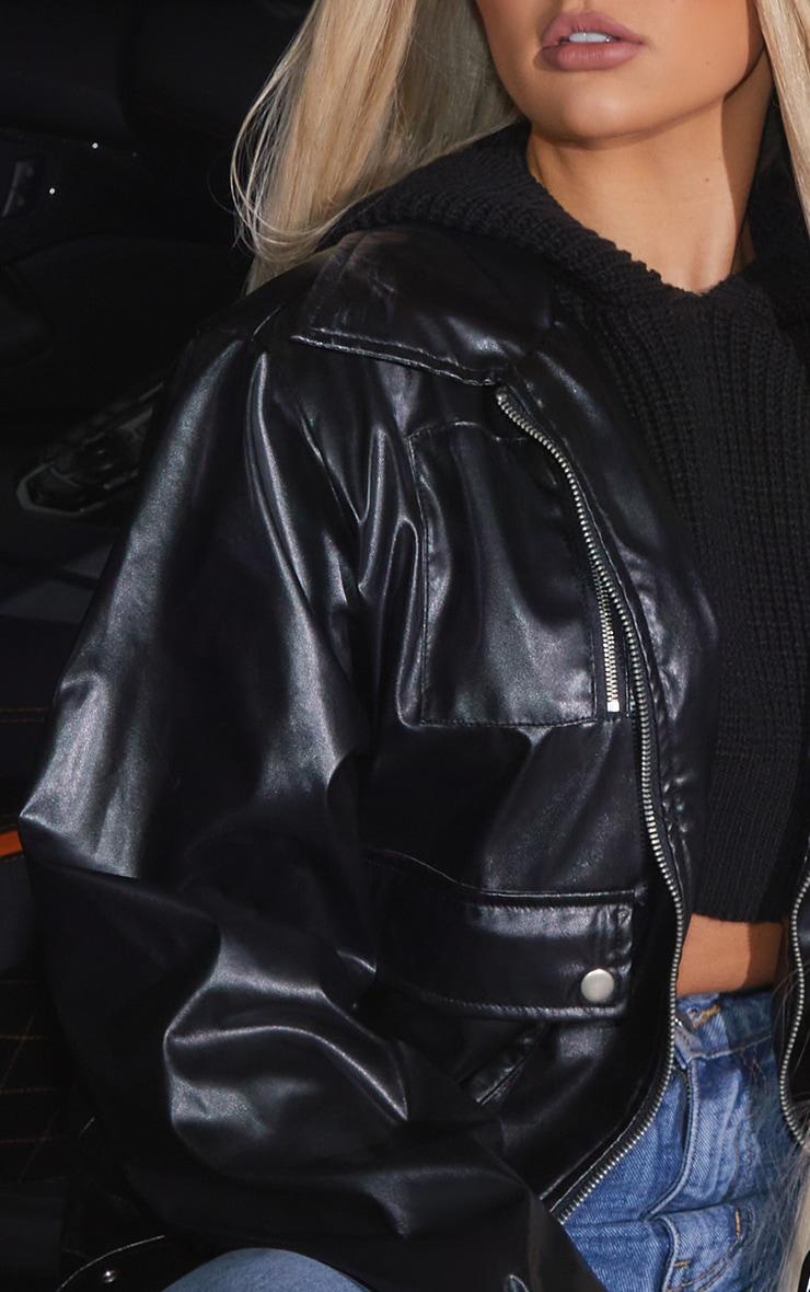 Veste en similicuir noire ceinturée à poches 4