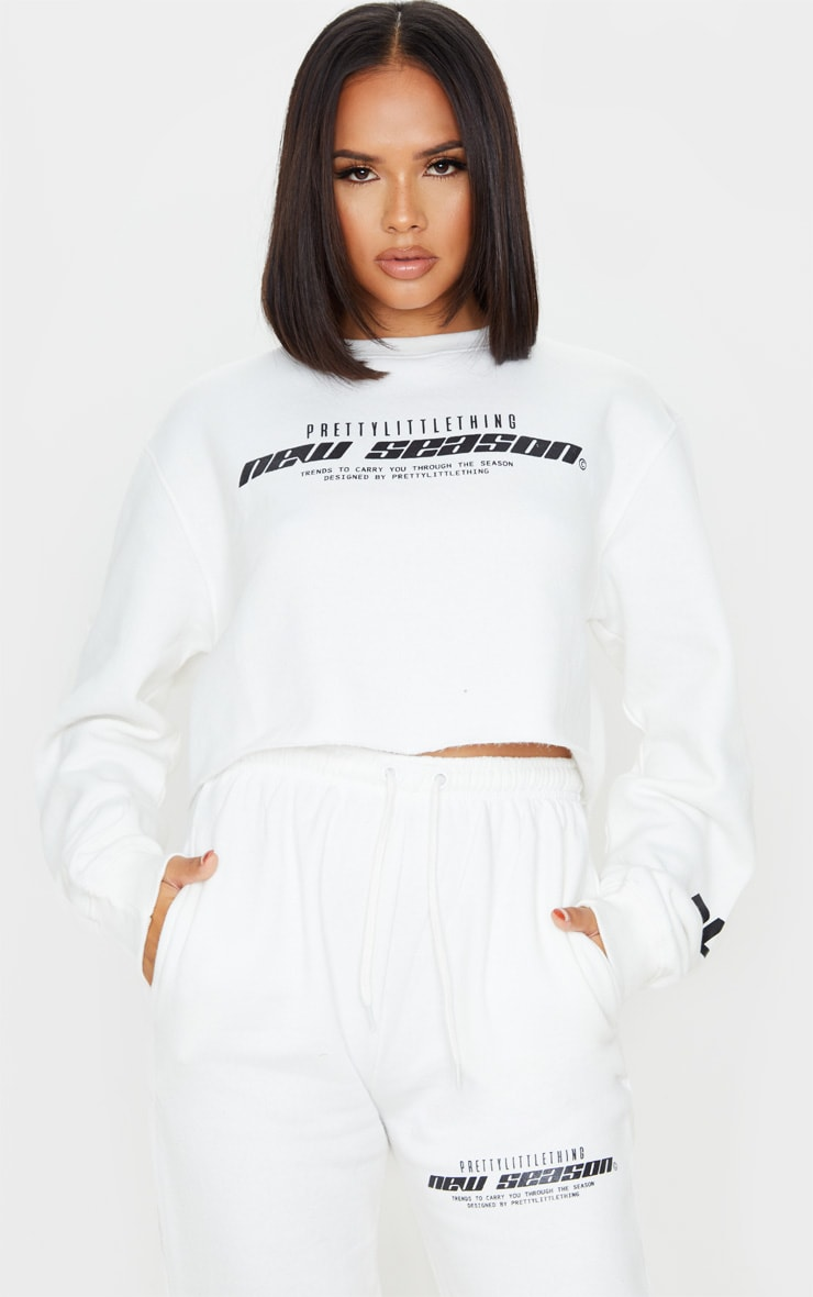 PRETTYLITTLETHING Cream New Season Slogan Cropped Sweater 1