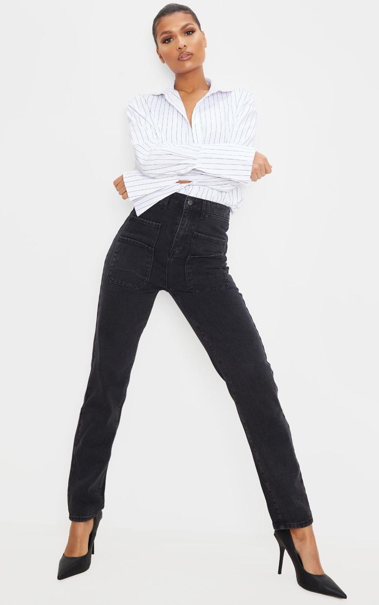 Jean droit noir délavé à détail poche 1